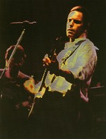 Bob Weir on his 42nd birthday, with Phil Lesh in the background