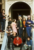 "Grateful Dead in front of 710 Ashbury Street: unidentified man, Ron ""Pigpen"" McKernan, Bill Kreutzmann, unidentified woman, Phil Lesh, Bob Weir, Jerry Garcia, and Rock Scully and Danny Rifkin in front"