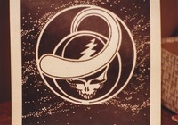 "Grateful Dead merchandise: unfinished drawing by Bob Thomas based on the ""Steal Your Face"" logo designed by him and Owsley Stanley, that was part of a display at an unknown location"