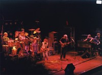 Grateful Dead and the Neville Brothers: Bill Kreutzmann, Mickey Hart, unidentified guitarist, Bob Weir, unidentified guitarist, Jerry Garcia, Brent Mydland, unidentified keyboardist