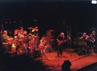 Grateful Dead and the Neville Brothers: Bill Kreutzmann, Mickey Hart, unidentified guitarist, Bob Weir, unidentified guitarist, Jerry Garcia, Brent Mydland, unidentified keyboardist