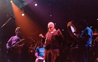 "Ken Nordine, with Bob Weir, Bill Kreutzmann, and Mickey Hart, reciting either ""Flibberty Jib"" or ""The Island"" during ""Drumz"""