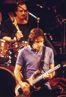 "Grateful Dead at the ""So Far"" video taping session: Bob Weir, with Bill Kreutzmann in the background"