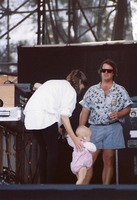 Unidentified mother and baby with an unidentified stage crew person