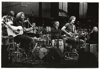 Grateful Dead during an acoustic set: Phil Lesh, Jerry Garcia, Mickey Hart, Bill Kreutzmann, Bob Weir, and Brent Mydland
