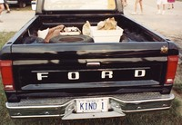 """Deadhead vehicle with """"KIND 1"""" Ontario license plate, ca. 1990"""