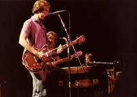 Grateful Dead: Bob Weir with Jerry Garcia and Brent Mydland in the background