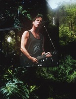 Bob Weir: portrait superimposed over a photograph of a tropical landscape