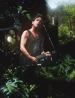 Bob Weir: portrait superimposed over a photograph of a tropical landscape