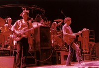 Grateful Dead: Phil Lesh, Bob Weir, with Bill Kreutzmann in the background