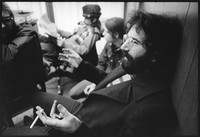 Jerry Garcia, with other band members in the background
