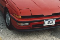 "Deadhead vehicle with ""LL RAIN 1"" Illinois license plate, ca. 1990"