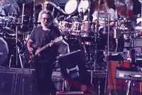 Jerry Garcia, with Bill Kreutzmann in the background