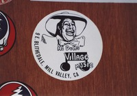 Grateful Dead merchandise:  promotional sticker for John Goddard's Village Music in Mill Valley, featuring a likeness of Cab Calloway as its logo, that was part of a display at an unknown location