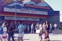 "Deadheads outside the Shoreline Amphitheatre entrance, with ""Grateful Dead"" on the marquee"