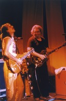"Carlos Santana and Jerry Garcia performing ""Fire On The Mountain"""
