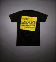 "T-shirt: ""Bill Graham Presents Mumbo in the Jumbo"". Back: ""New Year's Eve 1990-1991 - Grateful Dead - Branford Marsalis - Rebirth Brass Band - Oakland Coliseum"""