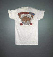 "T-shirt: ""Buffalo Dead 1990"" - skull on nickel. Back: ""Grateful Dead / Good Ol' Grateful Dead / 25 Years"" - buffalo head nickel"