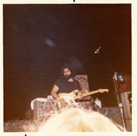 Jerry Garcia, with his guitar, Alligator