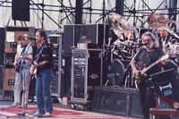Grateful Dead: Phil Lesh, Bob Weir and Jerry Garcia, with Bill Kreutzmann in the background