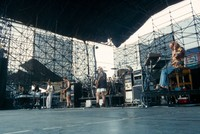 Grateful Dead: Phil Lesh, Bob Weir, Jerry Garcia, and Vince Welnick, with unidentified sound technician