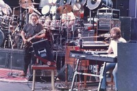 Grateful Dead: Jerry Garcia and Brent Mydland, with Bill Kreutzmann and Mickey Hart, obscured