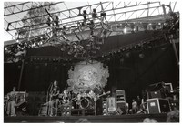 Grateful Dead: Phil Lesh, Bob Weir, Jerry Garcia, Brent Mydland, with Bill Kreutzmann and Mickey Hart in the background