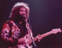 Jerry Garcia in a skull and roses jacket