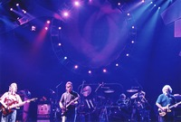 Grateful Dead: Phil Lesh, Bob Weir, and Jerry Garcia, with Bill Kreutzmann (obscured) and Mickey Hart in the background