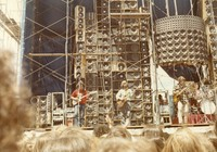 Grateful Dead: Jerry Garcia, Phil Lesh, Bob Weir, and Bill Kreutzmann in front of the Wall of Sound
