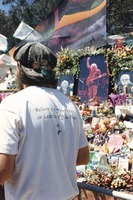 "Memorial for Jerry Garcia: ""Box of Rain"" lyric on a T-shirt, and the altar collection"