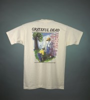 "T-shirt: ""Grateful Dead"" - skeleton Huckleberry Finn and Tom Sawyer, raft. Back: ""Grateful Dead / Spring '95 / [cities and dates]"" - skeleton Huckleberry Finn and Tom Sawyer, painting fence"