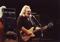 Jerry Garcia, with his guitar, Wolf