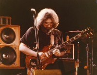 "Jerry Garcia, with his guitar ""Tiger"" at an unidentified venue, ca. 1981"