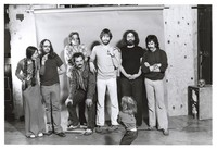 Grateful Dead publicity shoot at Club Front: Donna Godchaux, Keith Godchaux, Phil Lesh, Bill Kreutzmann, Bob Weir, Jerry Garcia, Mickey Hart, and an unidentified child (Zion Godchaux?)