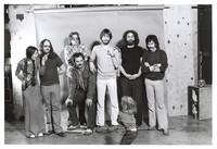 Grateful Dead publicity shoot at Club Front: Donna Godchaux, Keith Godchaux, Phil Lesh, Bill Kreutzmann, Bob Weir, Jerry Garcia, Mickey Hart, and an unidentified child (Zion Godchaux?)