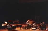 Phil Lesh, Bob Weir, and Vince Welnick, with an unknown pianist