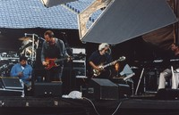 Grateful Dead and Sting: unidentified man, Sting, Jerry Garcia, and unidentified man, during Sting's set's last song