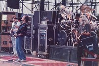 Grateful Dead: Phil Lesh, Bob Weir and Jerry Garcia, with Bill Kreutzmann, obscured
