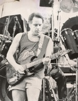 Grateful Dead, ca. 1990: Bob Weir, with Bill Kreutzmann in the background