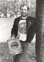 "Paul Grushkin holding a copy of his ""Grateful Dead: The Official Book of the Deadheads"", ca. 1983"