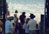 "Grateful Dead at ""A Day on the Green #8"": Donna Godchaux, Bob Weir, Jerry Garcia, Bill ""Kidd"" Candelario, and unidentified others"