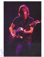 Bob Weir, with an acoustic guitar