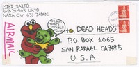 Decorated envelope with Elmo tickling a bear