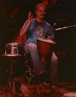 Bill Kreutzmann with a large talking drum, ca. 1983