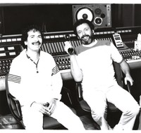 Carlos Santana and Bill Szymczyk in a recording studio