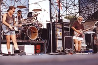 Grateful Dead: Bob Weir and Jerry Garcia, with Mickey Hart in the background