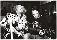 Wavy Gravy and Bob Weir, possibly at a Gibson guitar event, ca. 1994