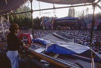 Grateful Dead at Seattle Center Memorial Stadium: distant view of the stage, unidentified sound technician, Deadheads