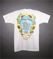 "T-shirt: ""Grateful Dead"" - skeleton, sunflowers. Back: ""Grateful Dead / Summer Tour 1994 / [cities]"""